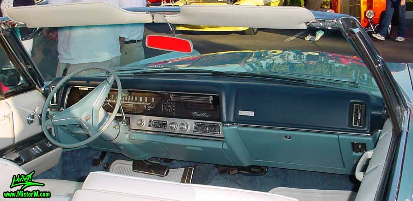 Photo of a bright blue 1967 Cadillac Convertible at the Scottsdale Pavilions Classic Car Show in Arizona. Dash Board of a 1967 Cadillac Convertible