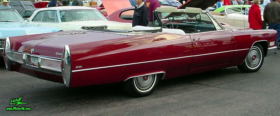 Photo of a burgundy red 1967 Cadillac deVille Convertible at the Scottsdale Pavilions Classic Car Show in Arizona. 67 Cadillac deVille Convertible