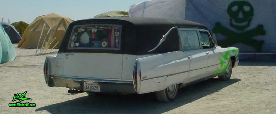 Photo of a white 1968 Cadillac Hearse at the Burning Man Festival in Black Rock City, Nevada. 1968 Cadillac Hearse