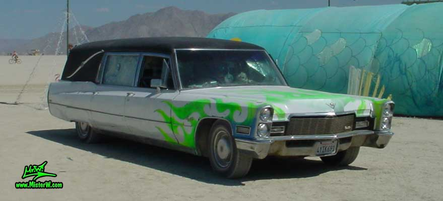 Photo of a white 1968 Cadillac Hearse at the Burning Man Festival in Black Rock City, Nevada. White 1968 Cadillac Hearse