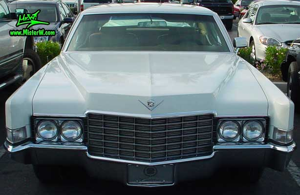 Photo of a white 1969 Cadillac 2 Door Hardtop Coupe DeVille at the Scottsdale Pavilions Classic Car Show in Arizona. 1969 Cadillac Chrome Grill