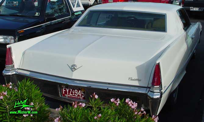 Photo of a white 1969 Cadillac 2 Door Hardtop Coupe DeVille at the Scottsdale Pavilions Classic Car Show in Arizona. 1969 Cadillac Rearview