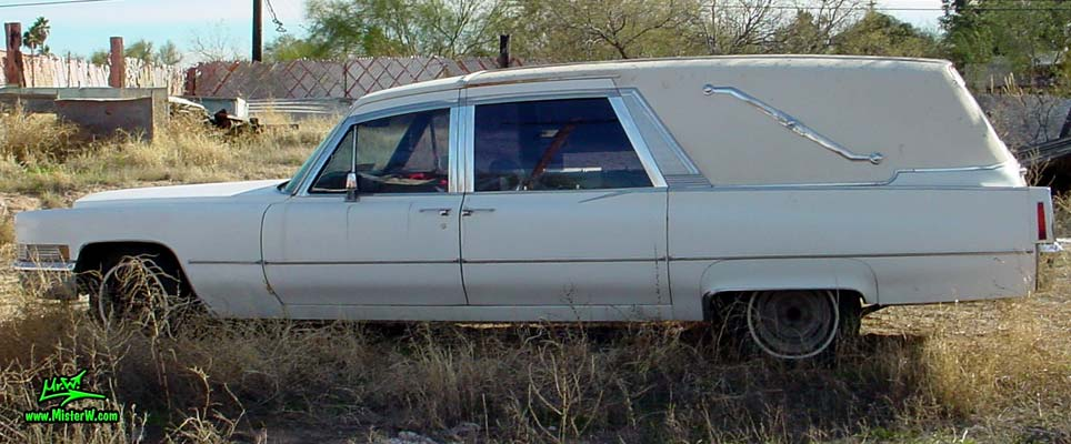 Photo of a white 1970 Cadillac Hearse in Tucson, Arizona. Huge 70 Caddilac Superior 3 Way Hearse with Suicide Doors