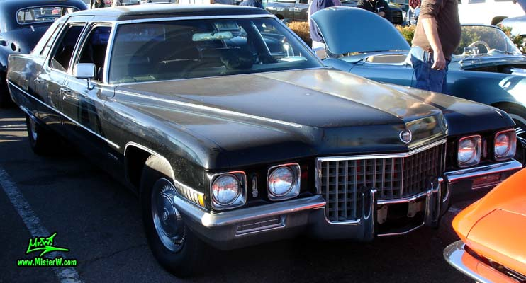 Photo of a black 1971 Cadillac Fleetwood Series 75 4 door limousine at the Scottsdale Pavilions Classic Car Show in Arizona. Front view of a 1971 Cadillac Fleetwood Series 75 limousine
