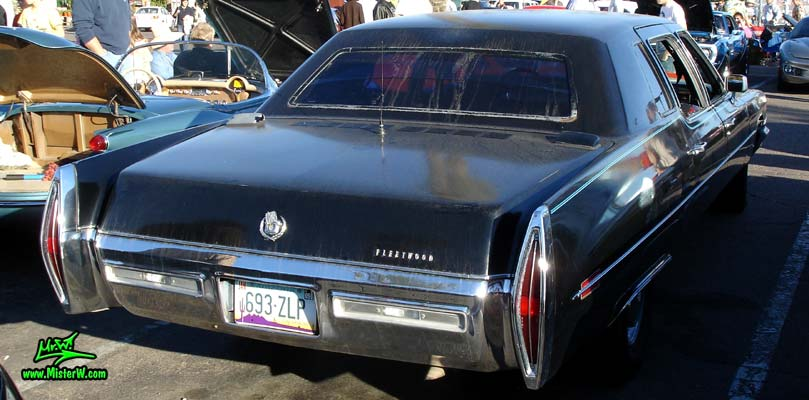 Photo of a black 1971 Cadillac Fleetwood Series 75 4 door limousine at the Scottsdale Pavilions Classic Car Show in Arizona. Side view of a 1971 Cadillac Fleetwood Series 75 limousine