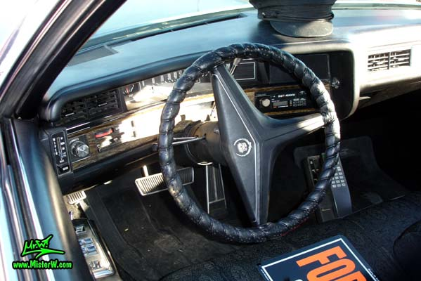 Photo of a black 1971 Cadillac Fleetwood Series 75 4 door limousine at the Scottsdale Pavilions Classic Car Show in Arizona. Dashboard & speedometer of a 1971 Cadillac Fleetwood Series 75 limousine