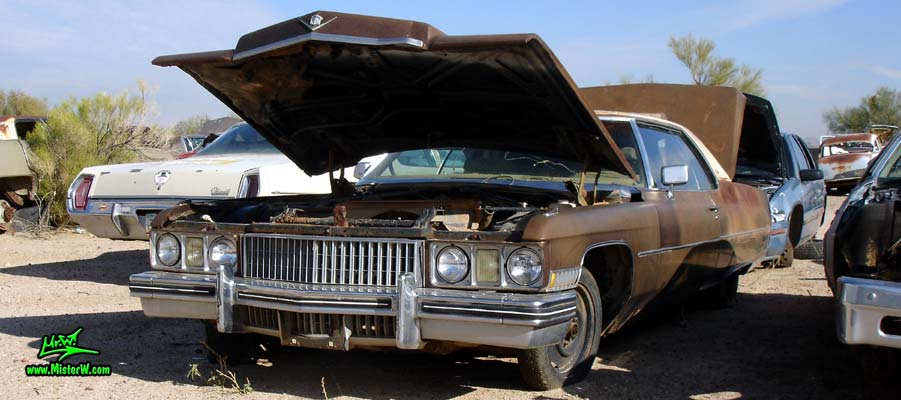 Photo of a brown 1973 Cadillac 2 door hardtop Coupe DeVille at a junk yard in Phoenix, Arizona. 1973 Cadillac Coupe de Ville