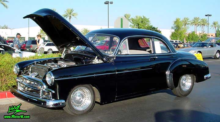Photo of a black 1950 Chevrolet 2 Door Hardtop Coupe at the Scottsdale Pavilions Classic Car Show in Arizona. 1950 Chevrolet