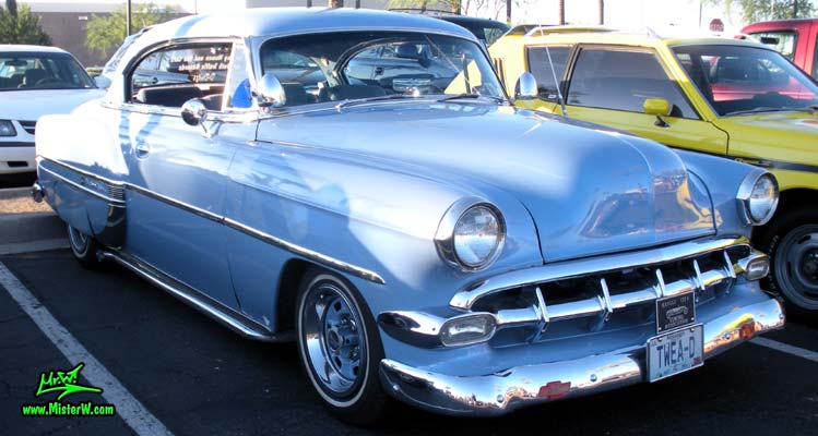 Photo of a blue 1954 Chevrolet Bel Air 2 Door Hardtop Coupe at the Scottsdale Pavilions Classic Car Show in Arizona. 54 Chevy Bel Air Coupe Sideview