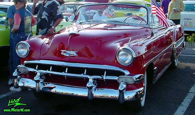 Photo of a red 1954 Chevrolet Convertible at the Scottsdale Pavilions Classic Car Show in Arizona. Red 1954 Chevrolet Convertible
