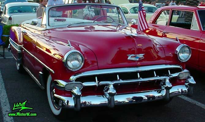 Photo of a red 1954 Chevrolet Convertible at the Scottsdale Pavilions Classic Car Show in Arizona. Front of a 1954 Chevrolet Convertible