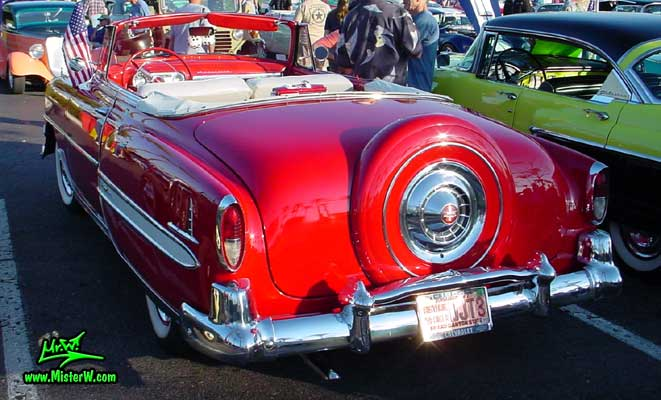 Photo of a red 1954 Chevrolet Convertible at the Scottsdale Pavilions Classic Car Show in Arizona. Back of a 1954 Chevrolet Convertible