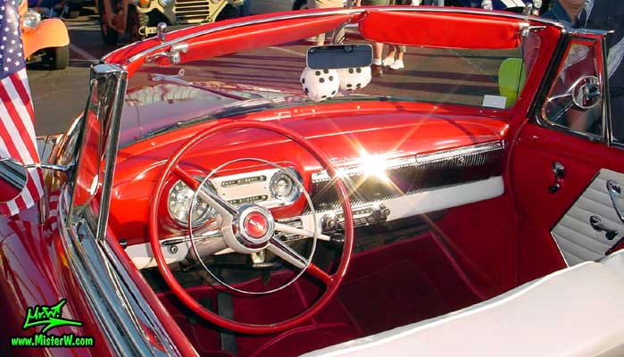 Photo of a red 1954 Chevrolet Convertible at the Scottsdale Pavilions Classic Car Show in Arizona. 1954 Chevrolet Convertible Odometer & Dashboard