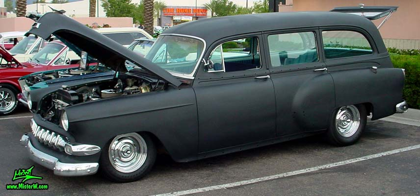 Photo of a flat black 1954 Chevrolet Station Wagon at the Scottsdale Pavilions Classic Car Show in Arizona. 54 Chevy Wagon