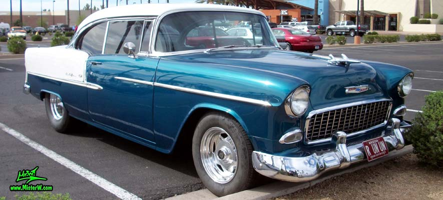 Photo of a blue & white 1955 Chevrolet Bel Air 2 Door Hardtop Coupe at the Scottsdale Pavilions Classic Car Show in Arizona. 55 Chevy Bel Air Coupe Chrome Grill
