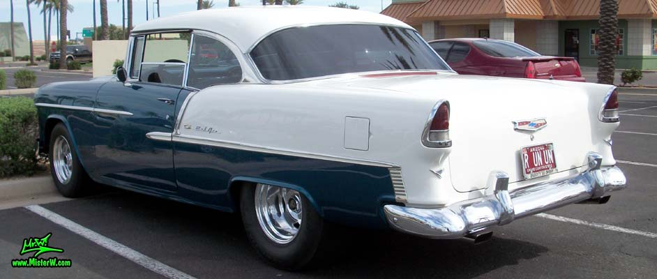 Photo of a blue & white 1955 Chevrolet Bel Air 2 Door Hardtop Coupe at the Scottsdale Pavilions Classic Car Show in Arizona. 55 Chevrolet Bel Air Coupe Tailfins
