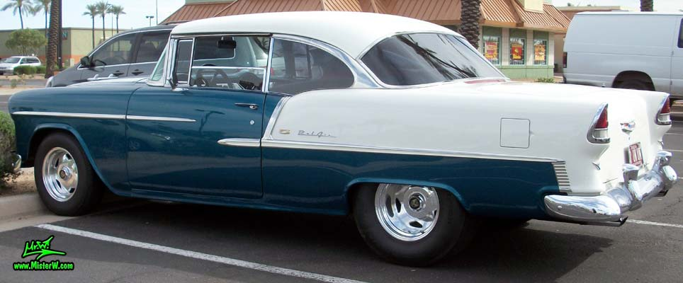 Photo of a blue & white 1955 Chevrolet Bel Air 2 Door Hardtop Coupe at the Scottsdale Pavilions Classic Car Show in Arizona. 55 Chevy Bel Air Tail Fins