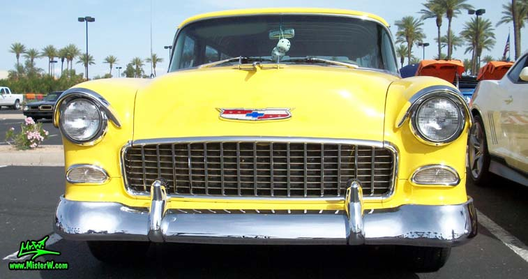 Photo of a yellow 1955 Chevrolet Bel Air Nomad 2 Door Station Wagon at the Scottsdale Pavilions Classic Car Show in Arizona. 1955 Chevrolet Bel Air Nomad Frontview