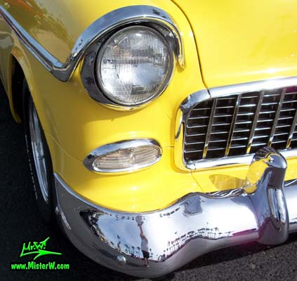 Photo of a yellow 1955 Chevrolet Bel Air Nomad 2 Door Station Wagon at the Scottsdale Pavilions Classic Car Show in Arizona. 1955 Chevrolet Bel Air Nomad Headlight & Blinker