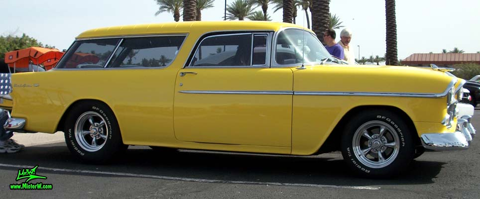 Photo of a yellow 1955 Chevrolet Bel Air Nomad 2 Door Station Wagon at the Scottsdale Pavilions Classic Car Show in Arizona. 1955 Chevrolet Bel Air Nomad Sideview