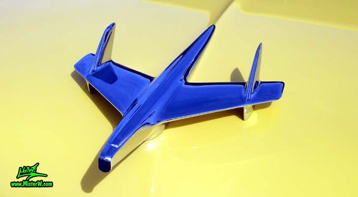 Photo of a yellow 1955 Chevrolet Bel Air Nomad 2 Door Station Wagon at the Scottsdale Pavilions Classic Car Show in Arizona. 1955 Chevrolet Bel Air Nomad Chrome Hood Ornament