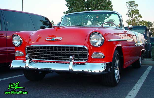 Photo of a red & white 1955 Chevrolet Bel Air Convertible at the Scottsdale Pavilions Classic Car Show in Arizona. 1955 Chevy Convertible