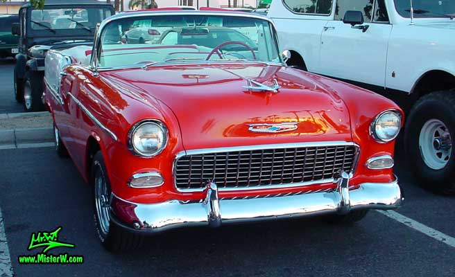 Photo of a red & white 1955 Chevrolet Bel Air Convertible at the Scottsdale Pavilions Classic Car Show in Arizona. 1955 Chevrolet Bel Air Convertible front Chrome Grill