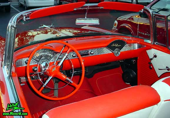Photo of a red & white 1955 Chevrolet Bel Air Convertible at the Scottsdale Pavilions Classic Car Show in Arizona. 1955 Chevrolet Bel Air Convertible Odometer & Dash Board
