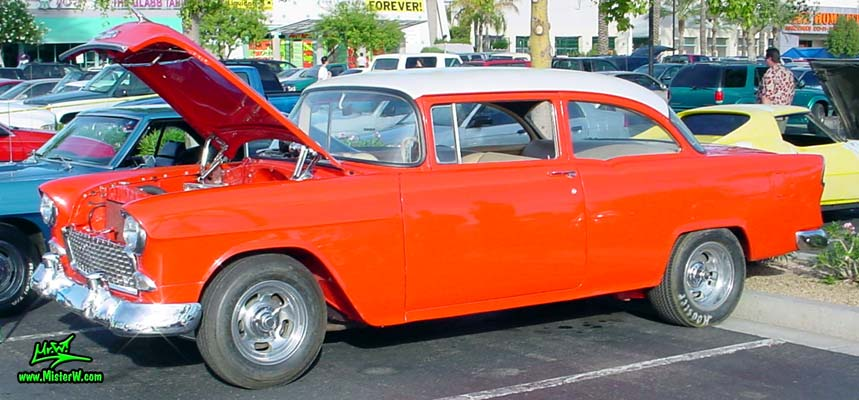 Photo of a red 1955 Chevrolet 2 Door Post Coupe at the Scottsdale Pavilions Classic Car Show in Arizona. 55 Chevy Sideview