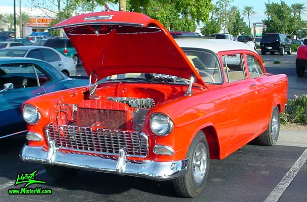 Photo of a red 1955 Chevrolet 2 Door Post Coupe at the Scottsdale Pavilions Classic Car Show in Arizona. 55 Chevy Frontview