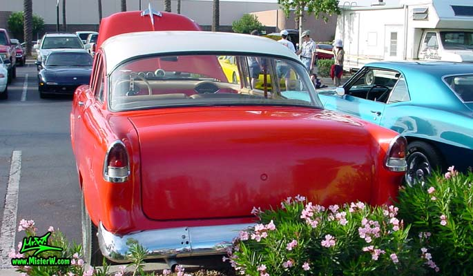 Photo of a red 1955 Chevrolet 2 Door Post Coupe at the Scottsdale Pavilions Classic Car Show in Arizona. 55 Chevy Rearview