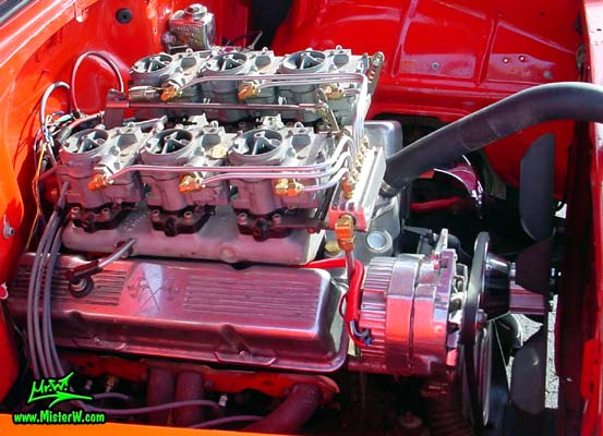 Photo of a red 1955 Chevrolet 2 Door Post Coupe at the Scottsdale Pavilions Classic Car Show in Arizona. 55 Chevy Engine Bay