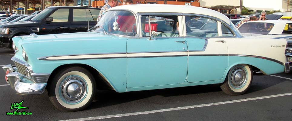 Photo of a white & blue 1956 Chevrolet Bel Air 4 Door Sedan at the Scottsdale Pavilions Classic Car Show in Arizona. 56 Chevy Bel Air