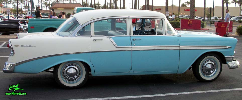 Photo of a white & blue 1956 Chevrolet Bel Air 4 Door Sedan at the Scottsdale Pavilions Classic Car Show in Arizona. Sideview of a 56 Chevrolet Bel Air