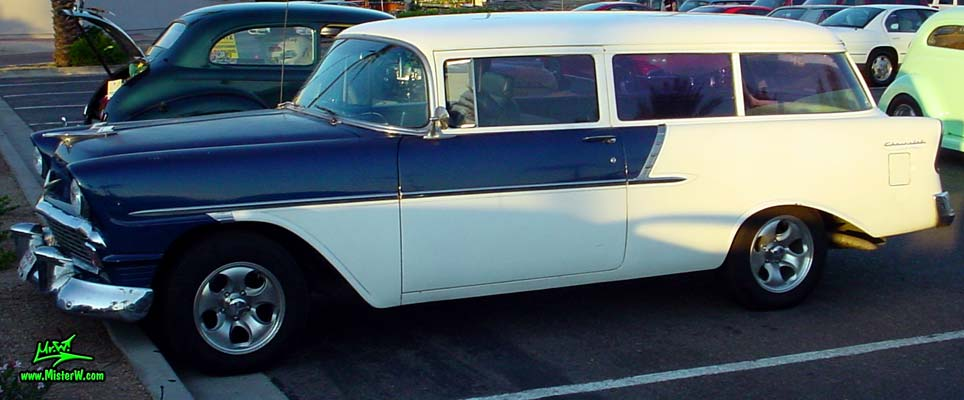 Photo of a white & blue 1956 Chevrolet 2 Door Station Wagon at the Scottsdale Pavilions Classic Car Show in Arizona. Sideview of a 56 Chevy 2 Door Station Wagon
