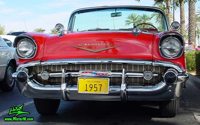 Photo of a red 1957 Chevrolet Bel Air Convertible at the Scottsdale Pavilions Classic Car Show in Arizona. 1957 Chevrolet Chrome Grill