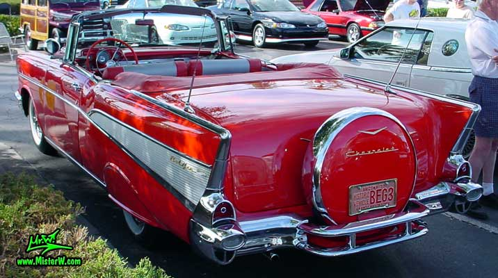 Photo of a red 1957 Chevrolet Bel Air Convertible at the Scottsdale Pavilions Classic Car Show in Arizona. 57 Chevy with Continental Kit
