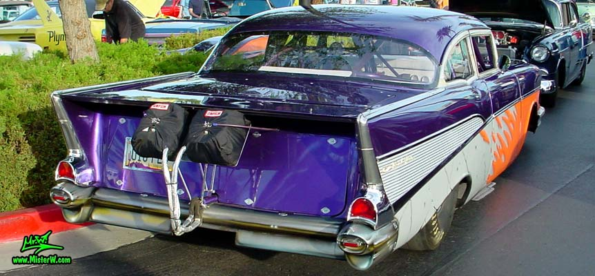 Photo of a purple 1957 Chevrolet 2 Door Hardtop Coupe Dragster Race Car at the Scottsdale Pavilions Classic Car Show in Arizona. 1957 Chevrolet Coupe Funny Race Car Tailfins