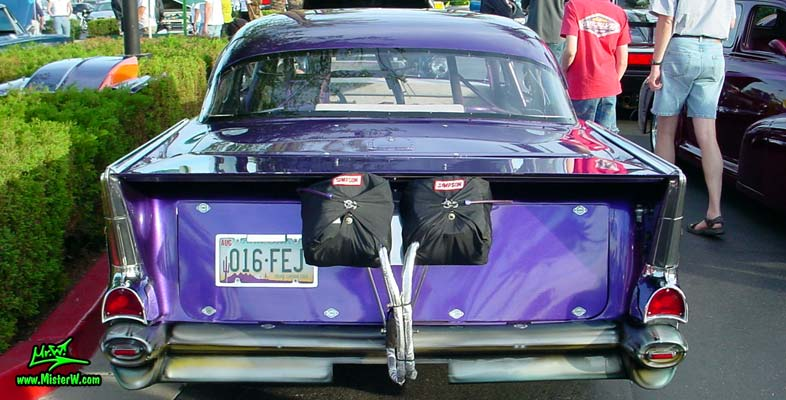 Photo of a purple 1957 Chevrolet 2 Door Hardtop Coupe Dragster Race Car at the Scottsdale Pavilions Classic Car Show in Arizona. Rearview of a 1957 Chevrolet Coupe Funny Race Car