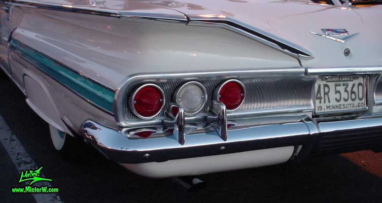 Photo of a white 1960 Chevrolet Impala Convertible at the Scottsdale Pavilions Classic Car Show in Arizona. 1960 Chevrolet Tail Lights