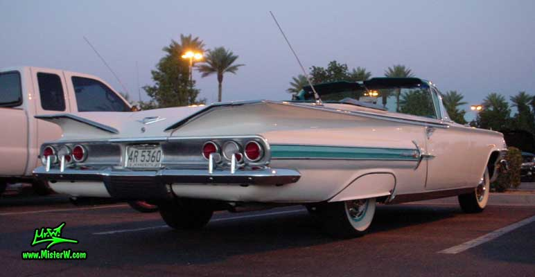 Photo of a white 1960 Chevrolet Impala Convertible at the Scottsdale Pavilions Classic Car Show in Arizona. 1960 Chevrolet Impala Convertible