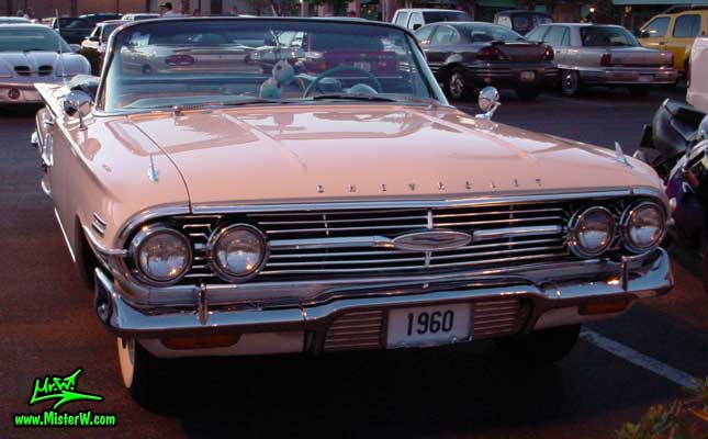 Photo of a white 1960 Chevrolet Impala Convertible at the Scottsdale Pavilions Classic Car Show in Arizona. 1960 Chevy Convertible