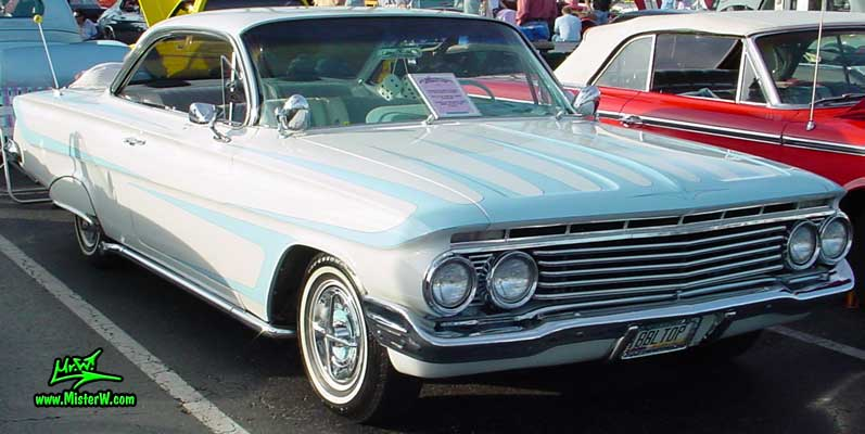 Photo of a white 1961 Chevrolet Impala 2 Door Hardtop Coupe at the Scottsdale Pavilions Classic Car Show in Arizona. 1961 Chevy Impala Coupe