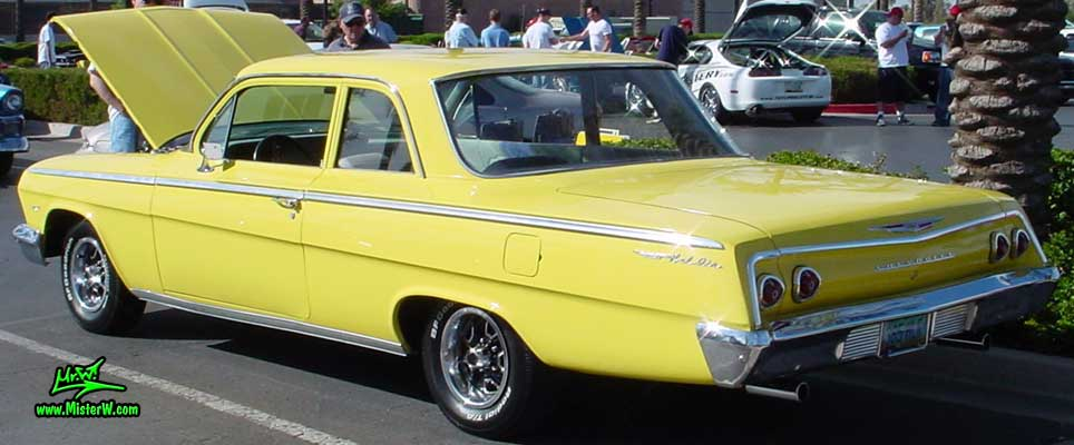 Photo of a yellow 1962 Chevrolet 2 Door Hardtop Coupe at the Scottsdale Pavilions Classic Car Show in Arizona. 1962 Chevy