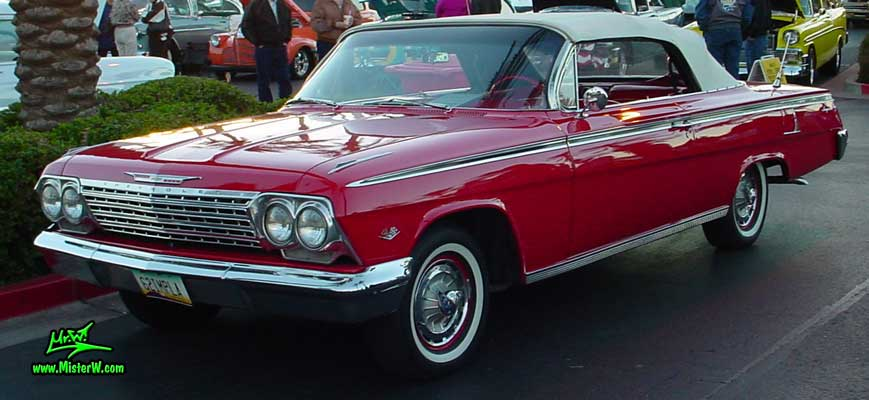 Photo of a red 1962 Chevrolet Impala Convertible at the Scottsdale Pavilions Classic Car Show in Arizona. 1962 Chevrolet Impala Convertible