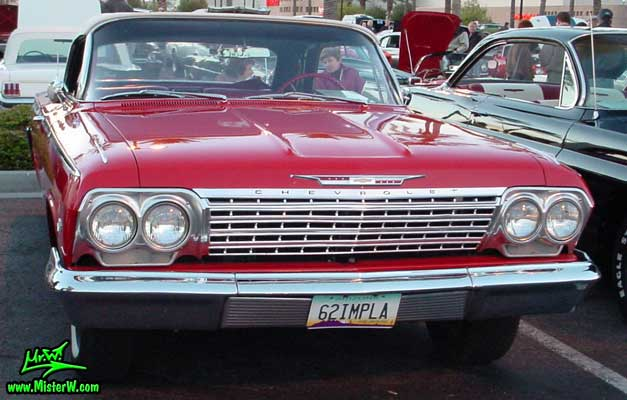 Photo of a red 1962 Chevrolet Impala Convertible at the Scottsdale Pavilions Classic Car Show in Arizona. 1962 Chevy Impala Convertible