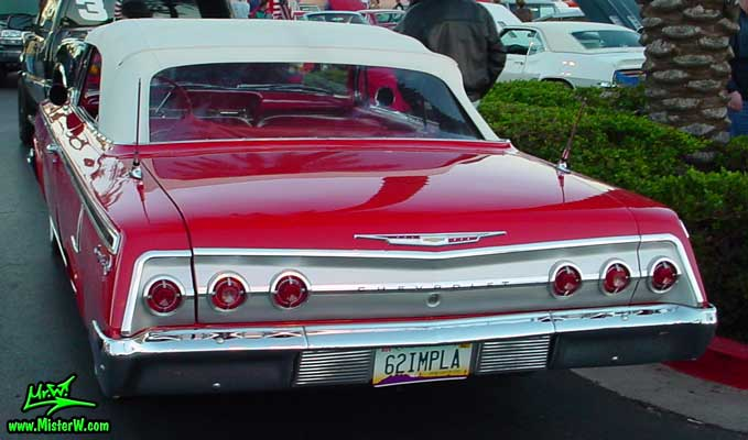 Photo of a red 1962 Chevrolet Impala Convertible at the Scottsdale Pavilions Classic Car Show in Arizona.