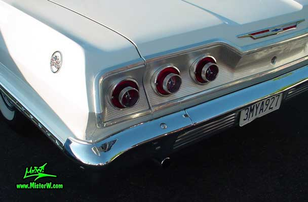 Photo of a white 1963 Chevrolet Impala 2 Door Hardtop Coupe at the Scottsdale Pavilions Classic Car Show in Arizona. 1963 Chevrolet Impala Tail Lights