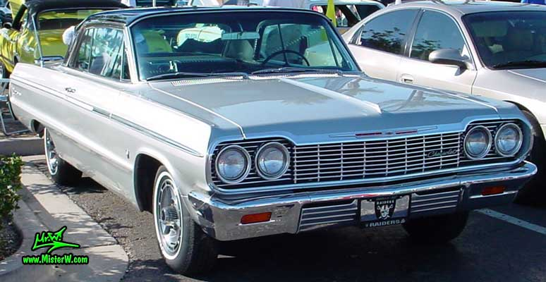 Photo of a silver grey 1964 Chevrolet 2 Door Hardtop Coupe at the Scottsdale Pavilions Classic Car Show in Arizona. 1964 Chevrolet Impala Coupe