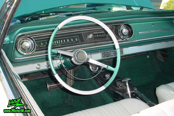 Photo of a turquoise 1965 Chevrolet Impala 2 Door Hardtop Coupe at the Scottsdale Pavilions Classic Car Show in Arizona. 1965 Chevrolet Dashboard